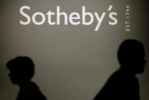 People pass by a Sotheby's auction house logo in the Russian History Museum in Moscow, May 23, 2007