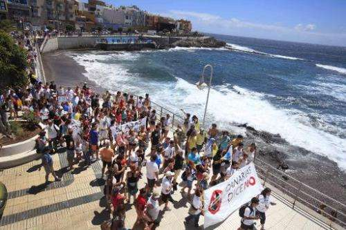 People protest against oil and gas exploration by Spanish group REPSOL off the coast of the Canary Islands, on the Spanish Canar