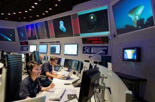 Scientists follow the flight of the Rosetta spacecraft from the control centre of the European Space Agency (ESA) in Darmstadt,