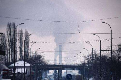 Smoke rises from the stacks of a thermal power station in Pernik on January 28, 2014