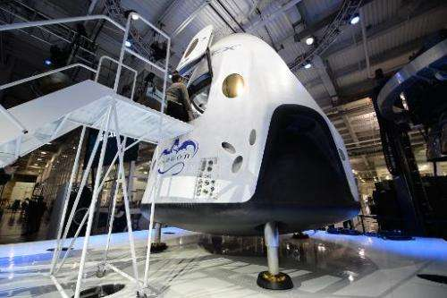 SpaceX's new seven-seat Dragon V2 spacecraft is seen at a press conference to unveil the new spaceship, in Hawthorne, California