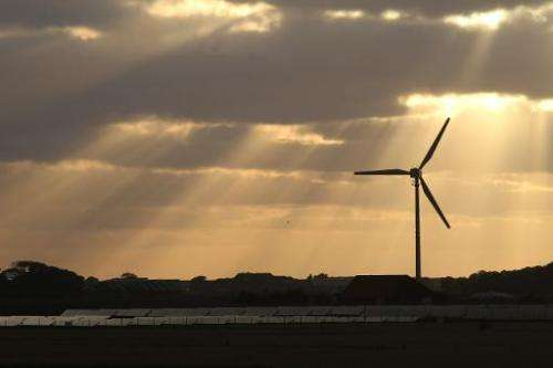 The sun shines on a wind and a solar hybrid parc on Pellworm island, northern Germany, on August 9, 2013