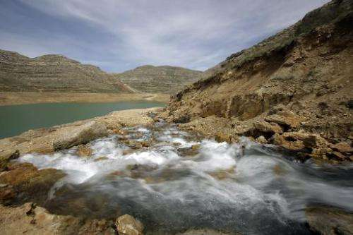 Water from the 'Al-Laban fountain' flows into the reservoir of a dam in Lebanon's Shabrouh mountains, north of the capital Beiru