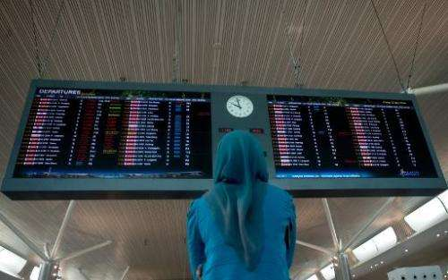 A woman looks at flight schedules at Kuala Lumpur International Airport 2 (KLIA2) in Sepang, outside Kuala Lumpur on May 2, 2014