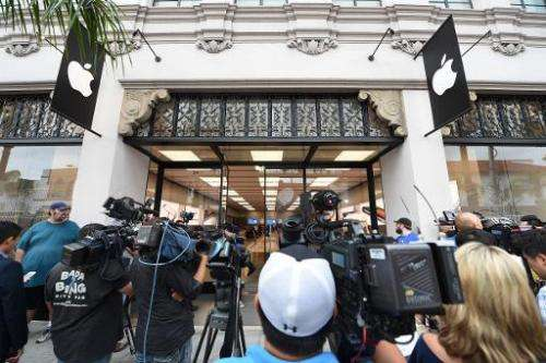 Members of the media gather outside the Apple store in Pasadena, California on September 19, 2014