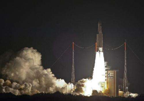 Picture taken and released on July 29, 2014 by the European Space Agency (ESA) shows an Ariane 5 ES heavy rocket carrying the Au