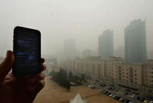 File photo of a cellphone showing the US Embassy pollution index reading of 551, which is extremely hazardous, and the Chinese g