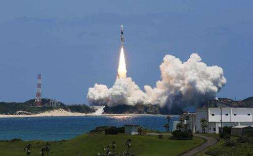 In this file photo, a rocket is seen lifting off from the space centre on Japan's southern island of Tanegashima, on May 24, 201