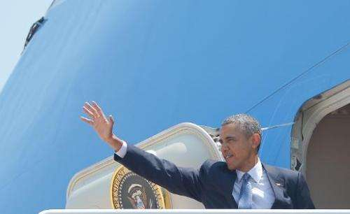 US President Barack Obama boards Air Force One on June 17, 2014 before departing from Andrews Air Force Base in Maryland