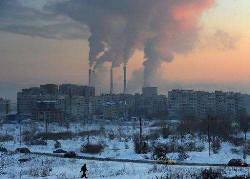 A file picture taken on January 31, 2012 in Sofia shows the sun rising behind chimneys of a thermal power station