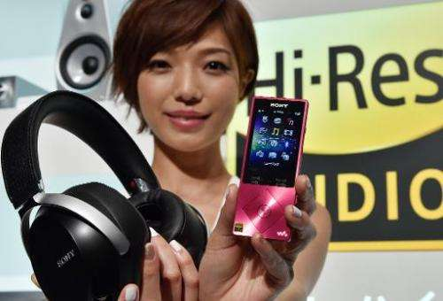 A model displays Japanese electronics giant Sony's portable digital audio player 'Walkman A series', designed to play the qualit