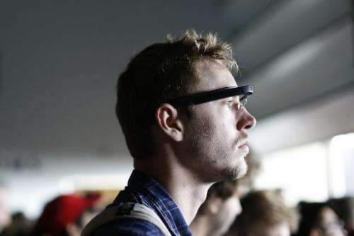 An attendee wears a Google Glass during the Google I/O Developers Conference in San Francisco, California, on June 25, 2014