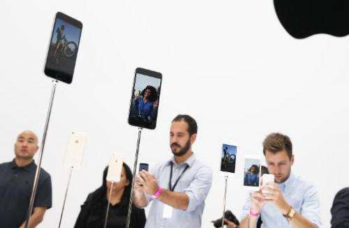 Attendees inspect the new iPhone 6 during an Apple special event at the Flint Center for the Performing Arts in Cupertino, Calif