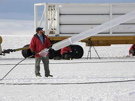 Hoisting a telescope with helium
