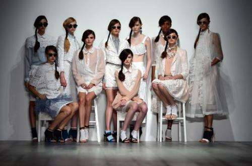 Models present creations by Bora Aksu during the 2015 Spring/Summer London Fashion Week in London on September 12, 2014