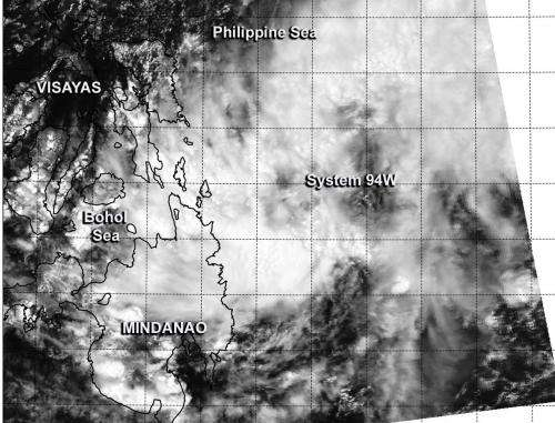 NASA's Aqua satellite sees Tropical System 94W affecting Philippines