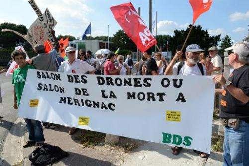 "People demonstrate against the presence of Israelian drone maker ""Israel Aerospace Industries"" at the UAV (Unmanned ae"