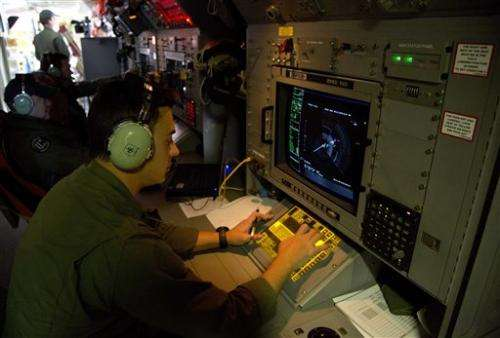Technology hindered, helped search for Flight 370