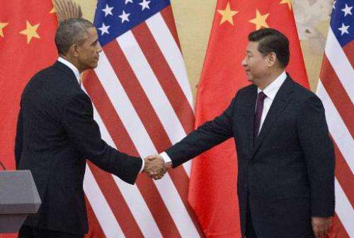 US President Barack Obama (L) and China President Xi Jinping shake hands following a bilateral meeting in Beijing on November 12