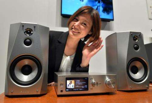 A model displays Japanese electronics giant Sony's hard-disc audio player system 'HAP-S1' and speaker system 'SS-HA1', in Tokyo,
