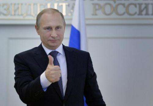 Russian President Vladimir Putin gives a thumbs up after watching a live broadcast of the launch of the Angara rocket from the P