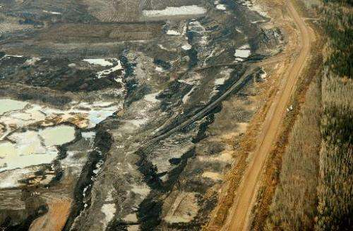 An aerial view of an oil sands mine near the town of Fort McMurray in Alberta Province, Canada on October 23, 2009