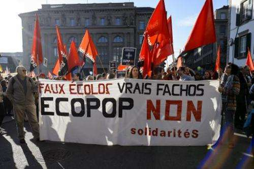 "Demonstrators hold a banner reading in French ""Fake ecologists, real fascists, No to ECOPOP"" during a demonstration in"