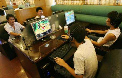 File picture shows Chinese students playing online computer games at an internet cafe in Hangzhou during their summer holidays,