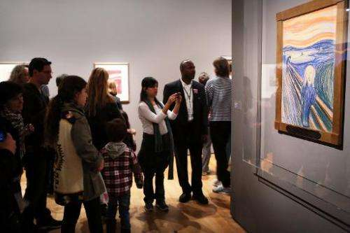 "People look at Edvard Munch's ""The Scream,"" in Manhattan's Museum of Modern Art (MOMA) in New York City"