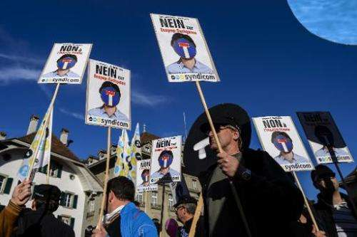 "Protesters hold placards reading in German ""No to Ecopop-dead end"" during a demonstration in Bern against an immigrati"