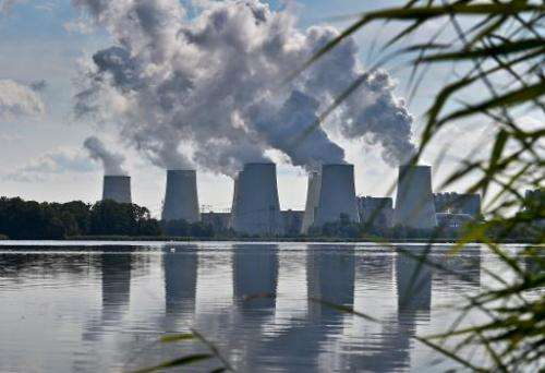 Smoke rises from the cooling towers of Vattenfall's lignite-fired power plant in Jaenschwalde, eastern Germany on August 25, 201