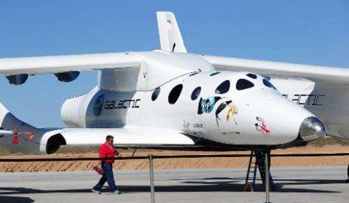 A man walks past the SpaceShipTwo vessel at Spaceport America, northeast of Truth Or Consequences, New Mexico, on October 17, 20