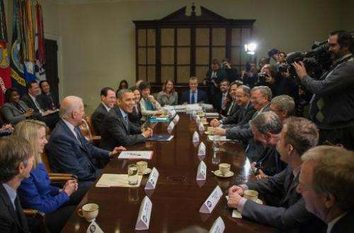 US President Barack Obama (4th L) and Vice President Joe Biden (3rd L) meet with executives from leading tech companies at the W