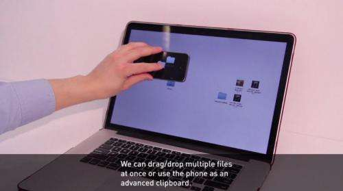 MIT groups develop smartphone system THAW that allows for direct interaction between devices