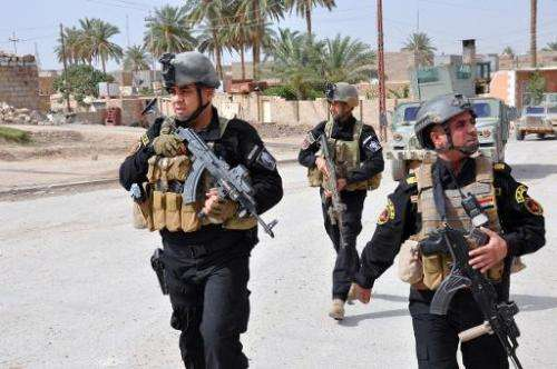 Members of the Iraqi Emergency Response Brigade patrol streets on June 24, 2014 in the western city of Ramadi in the Anbar provi