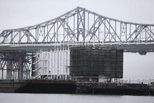 A barge under construction is docked at a pier on Treasure Island on December 2, 2013 in San Francisco, California