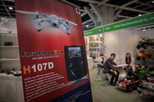 A billboard advertises a drone at the 40th Toys and Games Fair in Hong Kong, on January 8, 2014