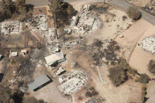 A charred landscape remains after a wildfire swept through the area, on July 7, 2013 in Yarnell, Arizona