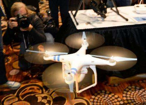 A DJI Innovations DJI Phantom 2 Vision aerial system is demonstrated in flight during a press event at the Mandalay Bay Conventi