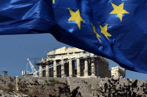 A European Union flag floats in the wind in front of the Acropolis in Athens on May 14, 2014