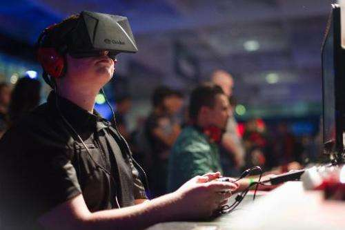 A gaming enthusiast using an Oculus virtual reality headset in London, on September 26, 2013