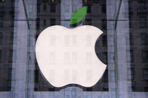 A green leaf adorns the Apple logo on Earth Day at the company's Fifth Avenue store in Midtown Manhattan on April 22, 2014 in Ne