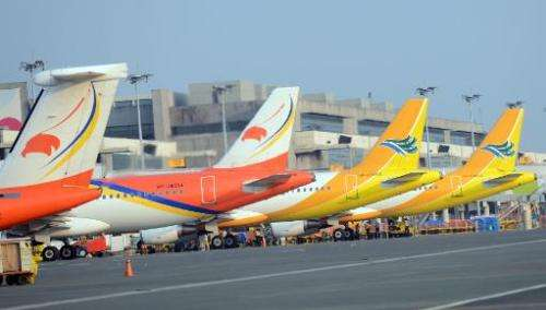 Aircraft of Philippine's largest budget carrier Cebu pacific (R) and Airphilippines (L), a subsidiary of flag carrier Philippine