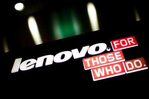 A Lenovo logo on display in Hong Kong on February 13, 2014. Shares in the Chinese technology giant drop 5% after it posts weaker