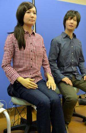 """A male and female humanoid robots called """"Actroid F"""", produced by Japan's National Institute of Advanced Industrial Sc"""