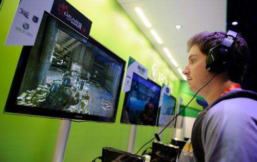 A man plays 'Gears of War 3' at Microsoft's Xbox 360 display at the 2012 International Consumer Electronics Show at the Las Vega