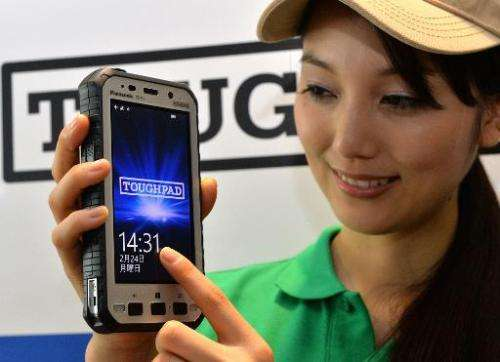 "A model displays a new Panasonic ""Toughpad FZ-X1"" heavy duty tablet in Tokyo on February 24, 2014"