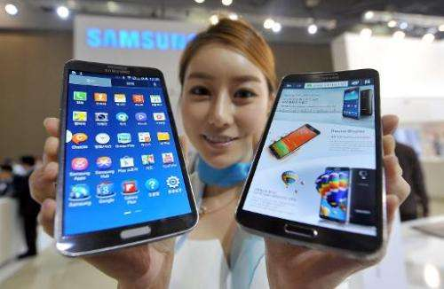 A model holds Samsung's first 'curved' smartphone Galaxy Round at the Electronics and IT Industry Fair in Goyang, north of Seoul