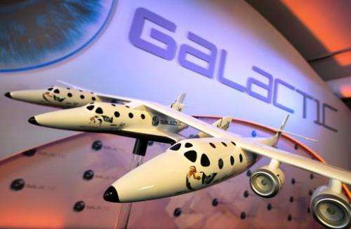 A model of the Virgin Galactic, the world's first commercial spaceline, is displayed at the Farnborough International Airshow in