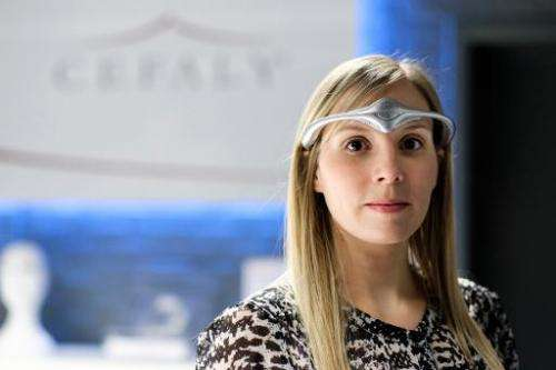 A model wears the classic model of Cefaly Technology's new head band device to be used against migraines at Cefaly Technology in